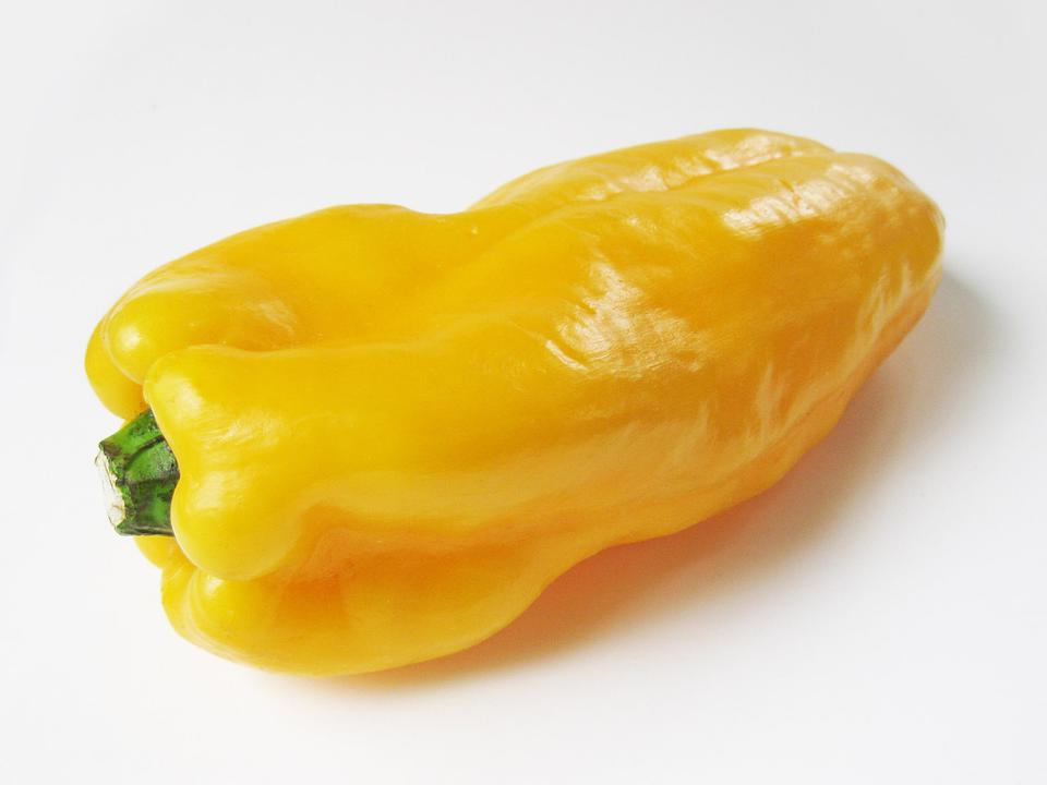 ripe yellow pepper isolated on white background