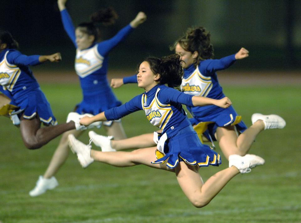 Cheerleaders Jumping In The Air
