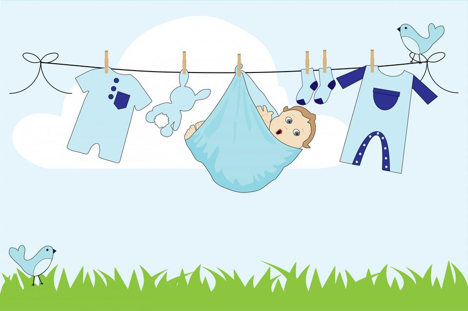 Cute baby boy dangling from clothes line
