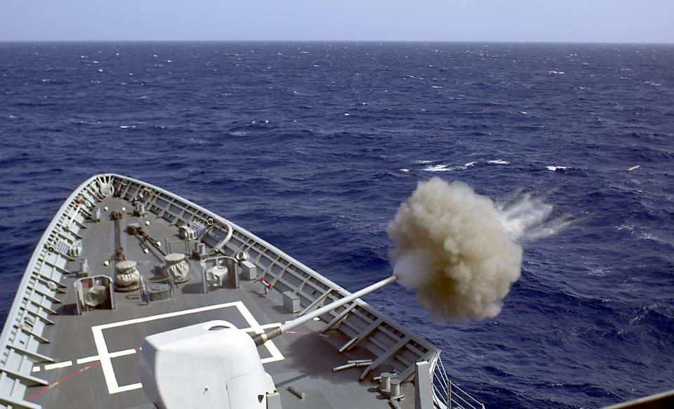 Fires its 5 inch gun at a target drone during a gun exercise