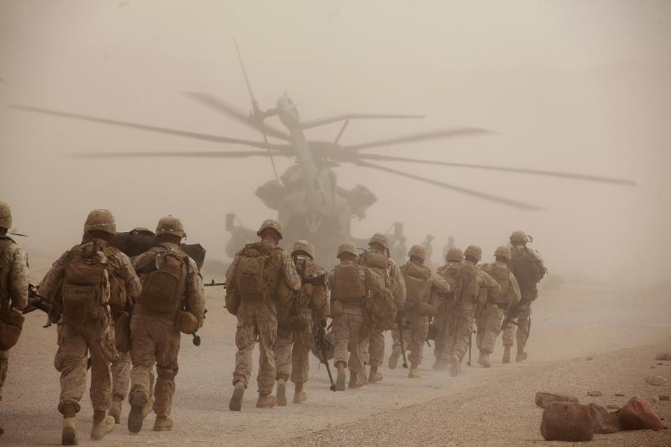 Marine Regiment, load onto a CH-53E Super Stallion helicopter