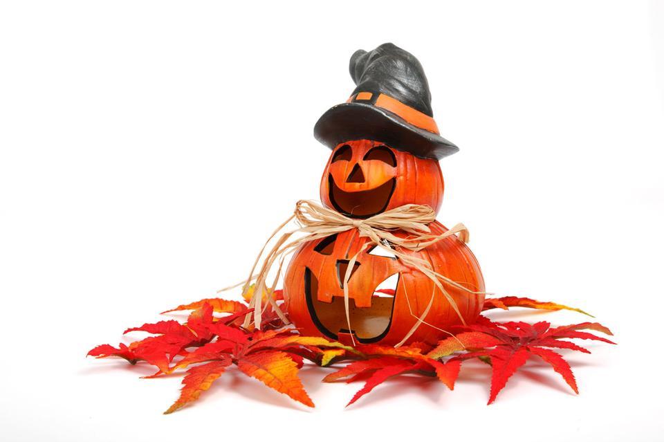 Smiling halloween pumpkin with autumn decoration
