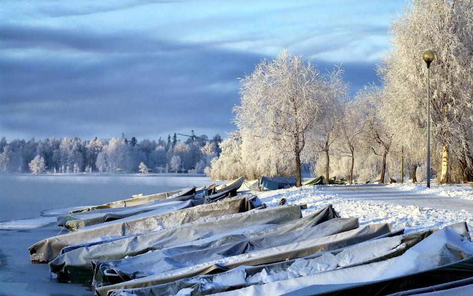 Boats covered with snow in Finland