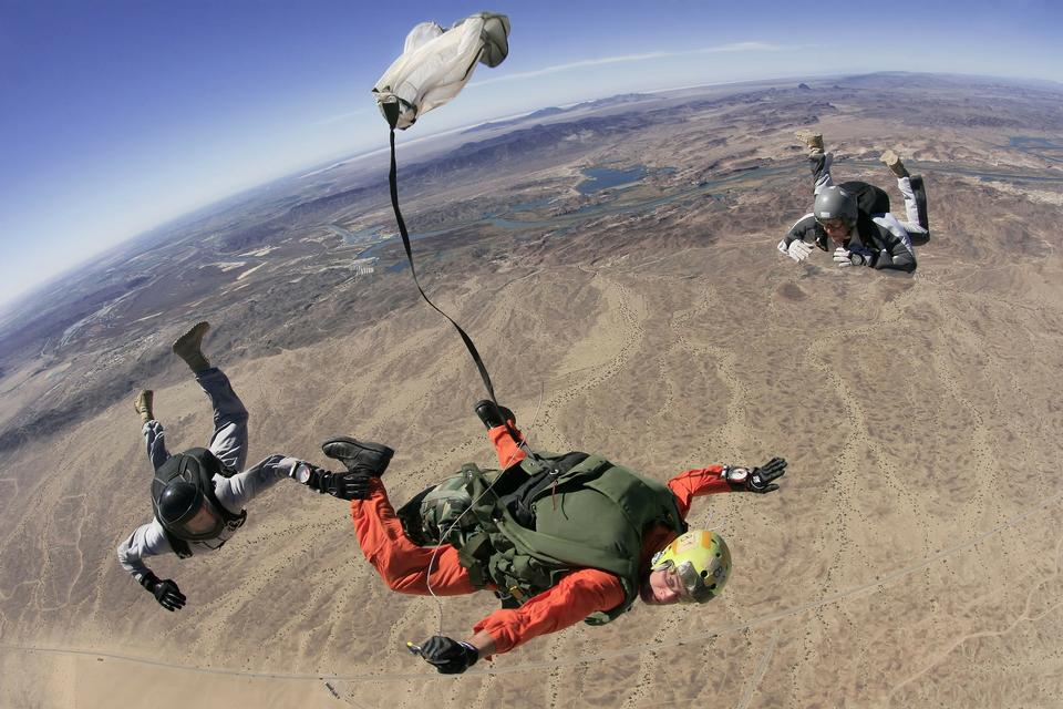 Skydive parachutists jump out of an airplane.