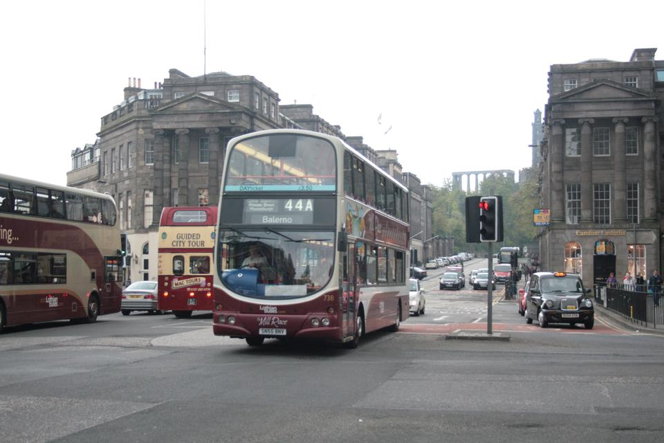 Red double decker on the streets