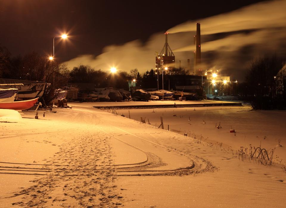 Winter landscape with factory chimneys and clouds