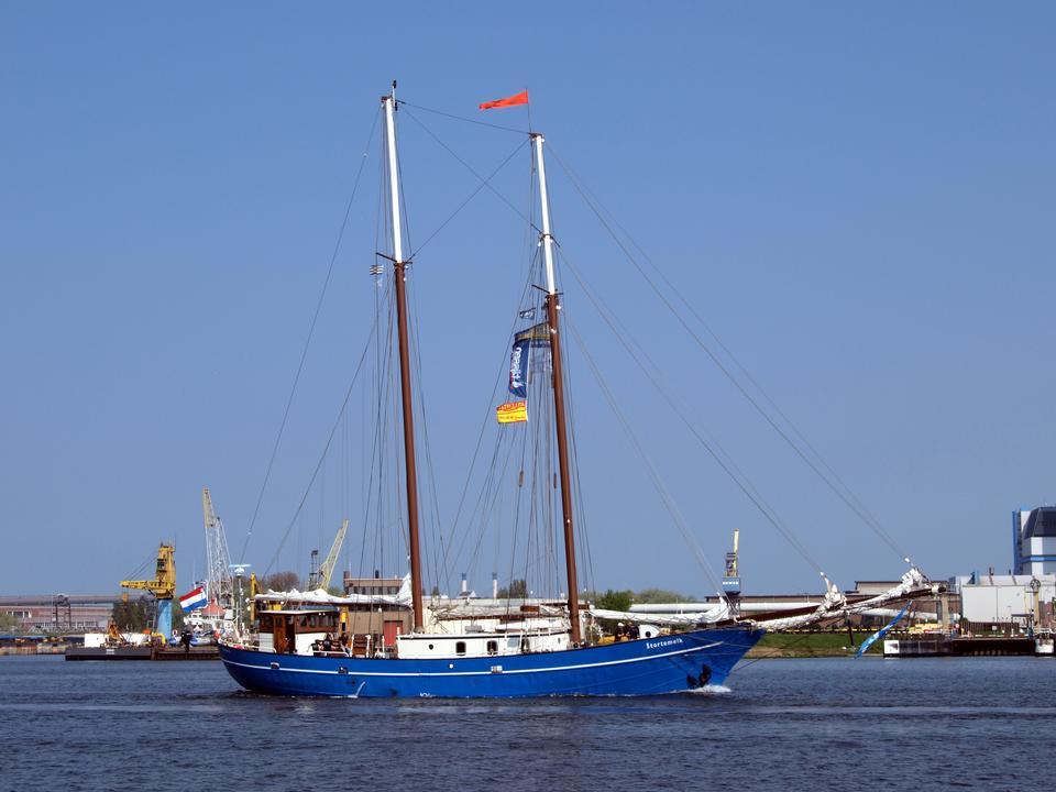 Blue sail yacht sailing