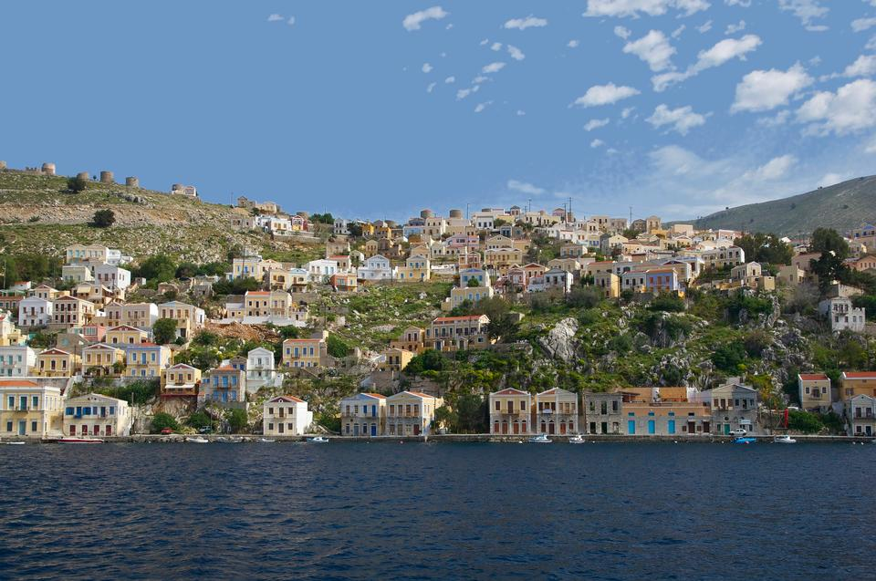 Colorful houses lining the harbor at Symi, Greece