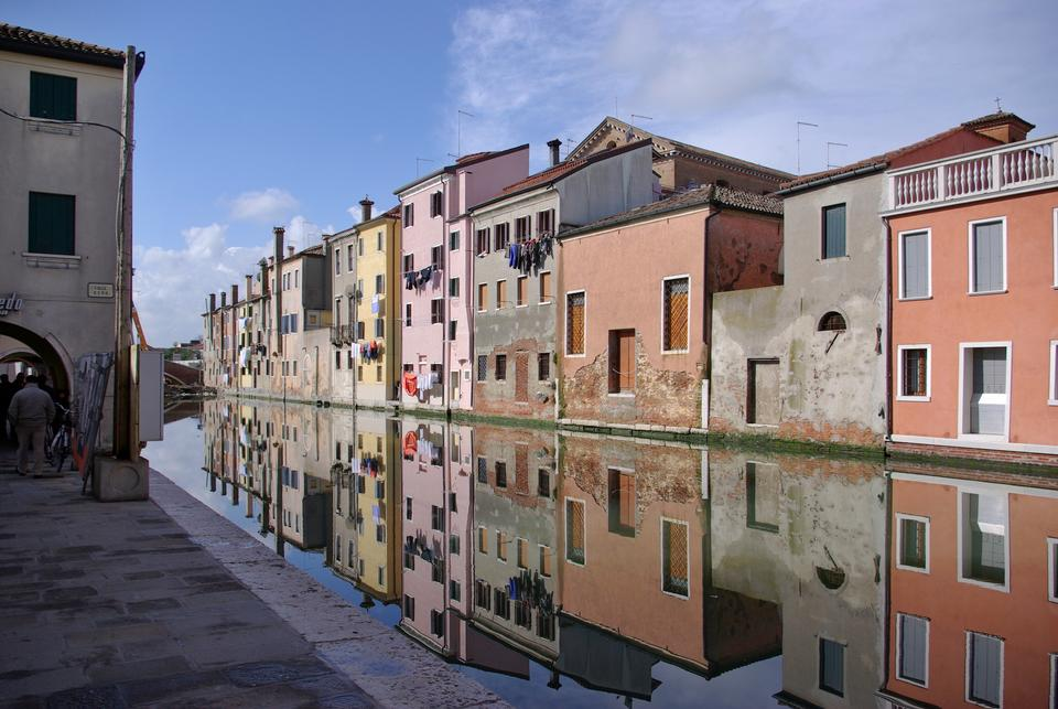 Chioggia Venice, typical houses along the canal with reflections
