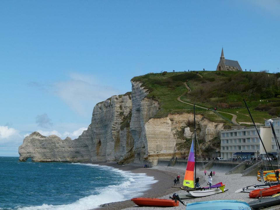 Sailboat on the bay beach in Etretat, France