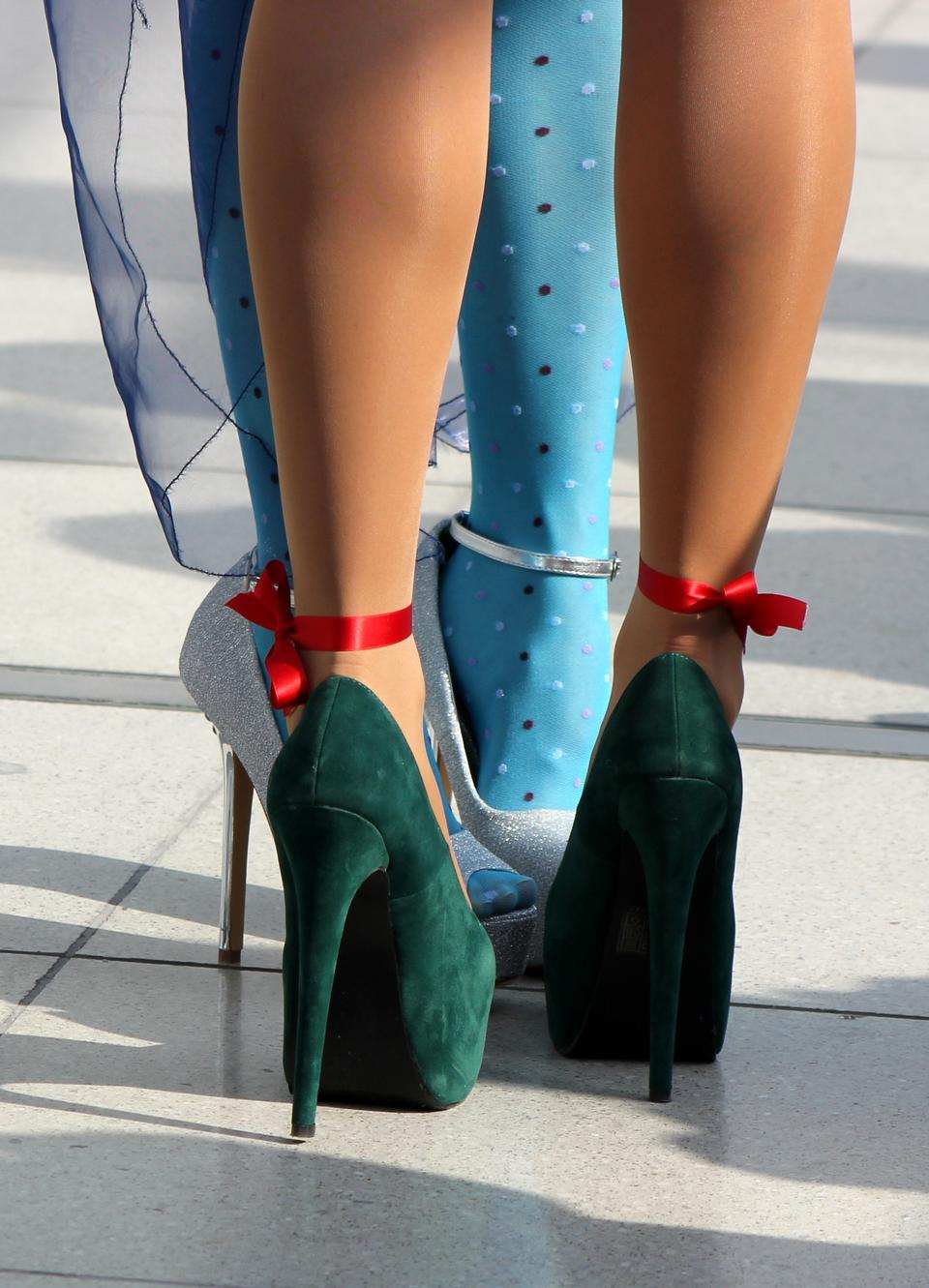 Sexy female high heeled green shoes on the way
