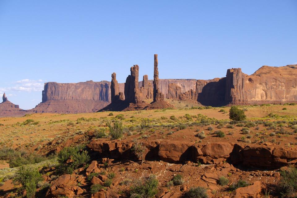 The Totem Pole and Yei Bi Chei rock formations in Monument Valley