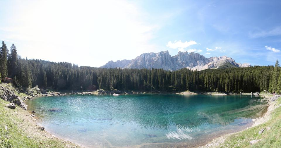Carezza lake and Latemar in summer season with clouds, Dolomites