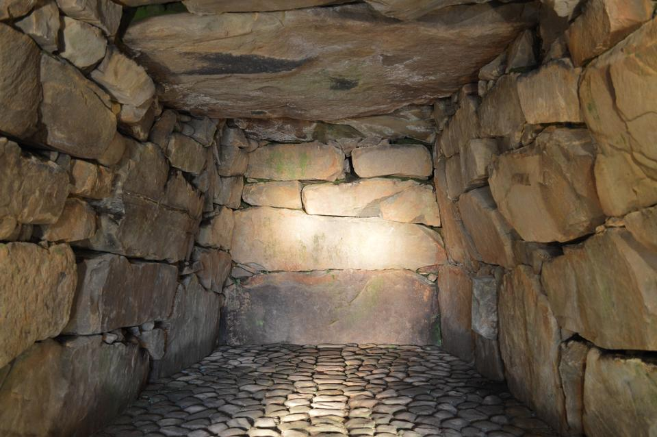 interior of ancient tomb or dwelling in sandstone cave