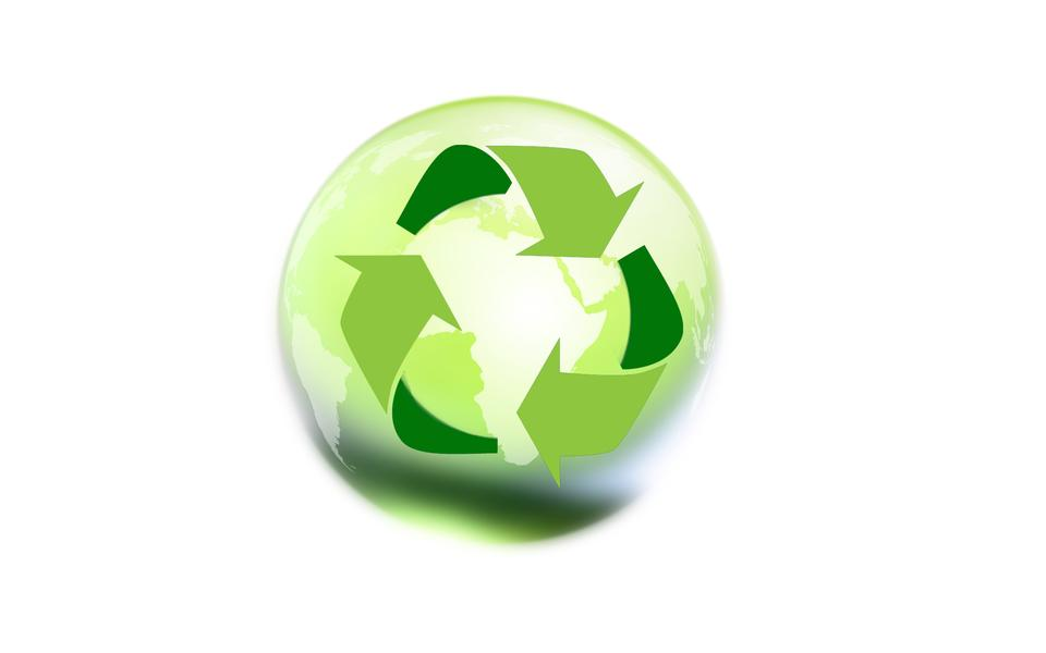 Recycle sign in the green glass sphere on white (Green concept)