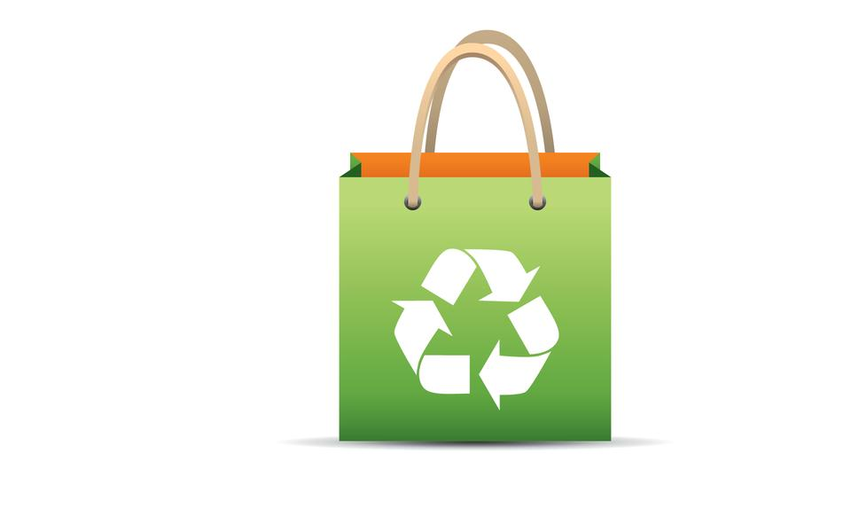 Green reusable shopping bag with recycle symbol