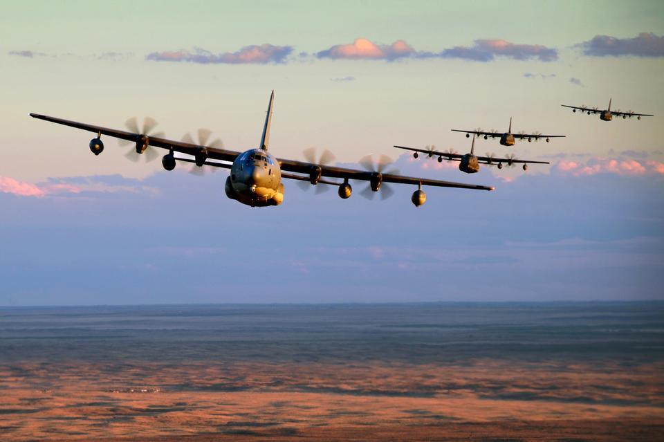 MC-130J Commando IIs conduct low-level formation training