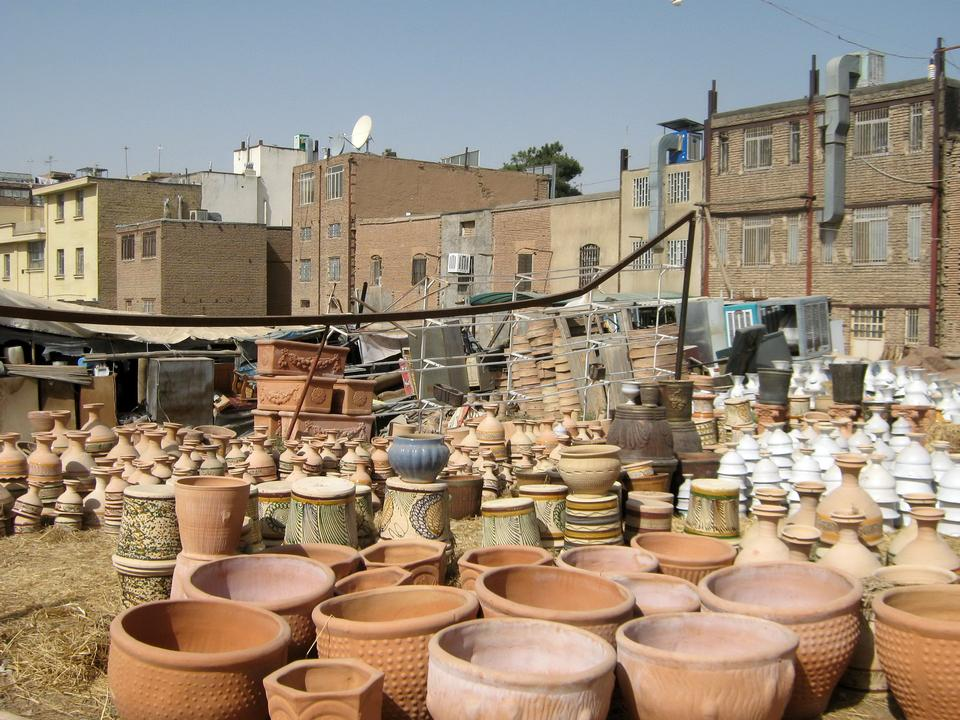 Handmade clay jugs in a pottery workshop