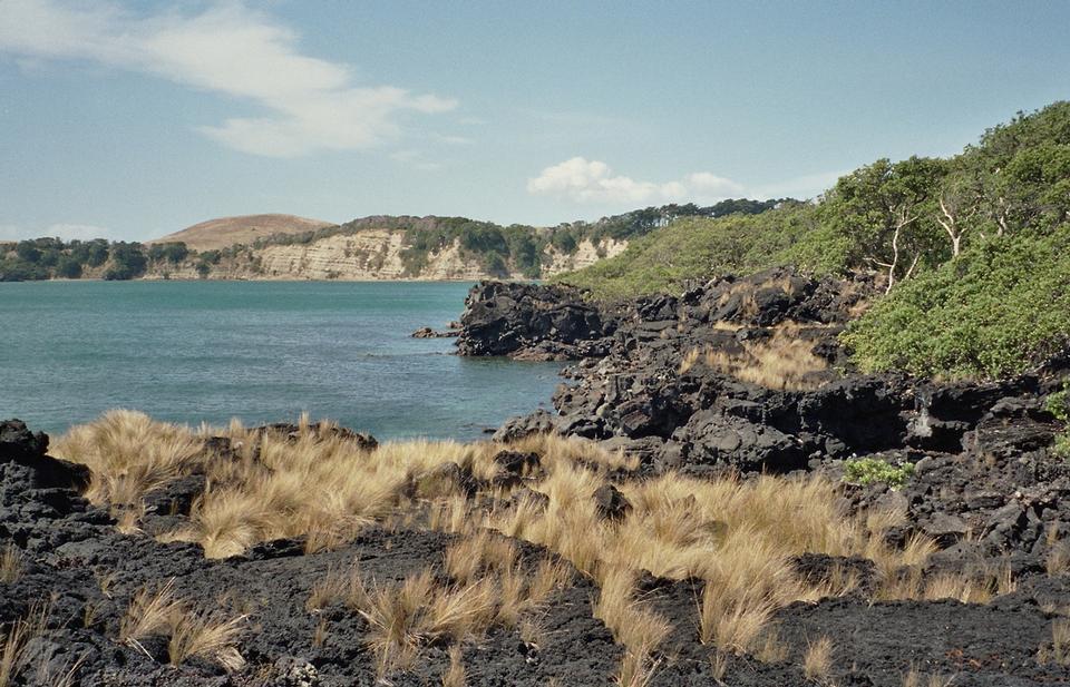 Lava beach on Rangitoto Island with Motutapu Island