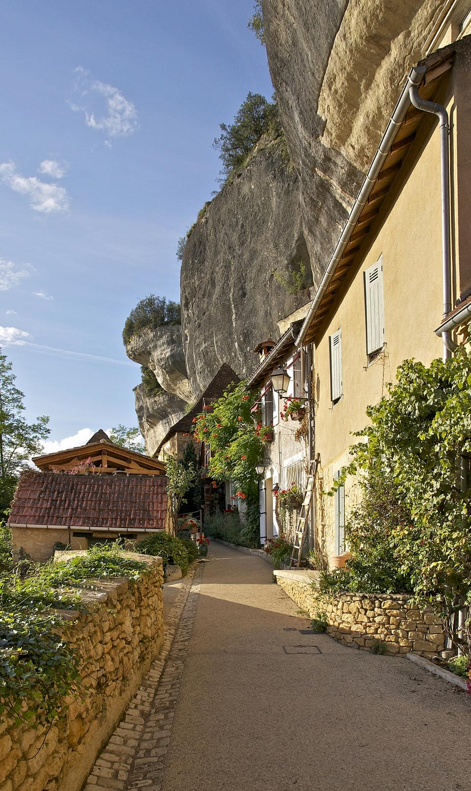 A lane under the cliff, Les Eyzies-de-Tayac, Dordogne, France
