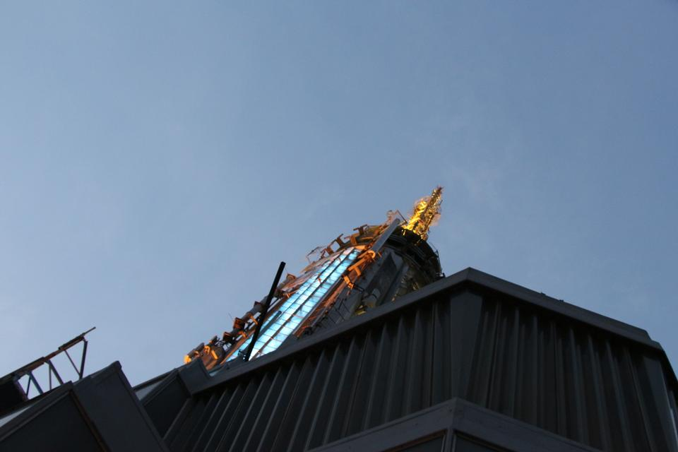 Top of Empire State Building in the night with metal antenna