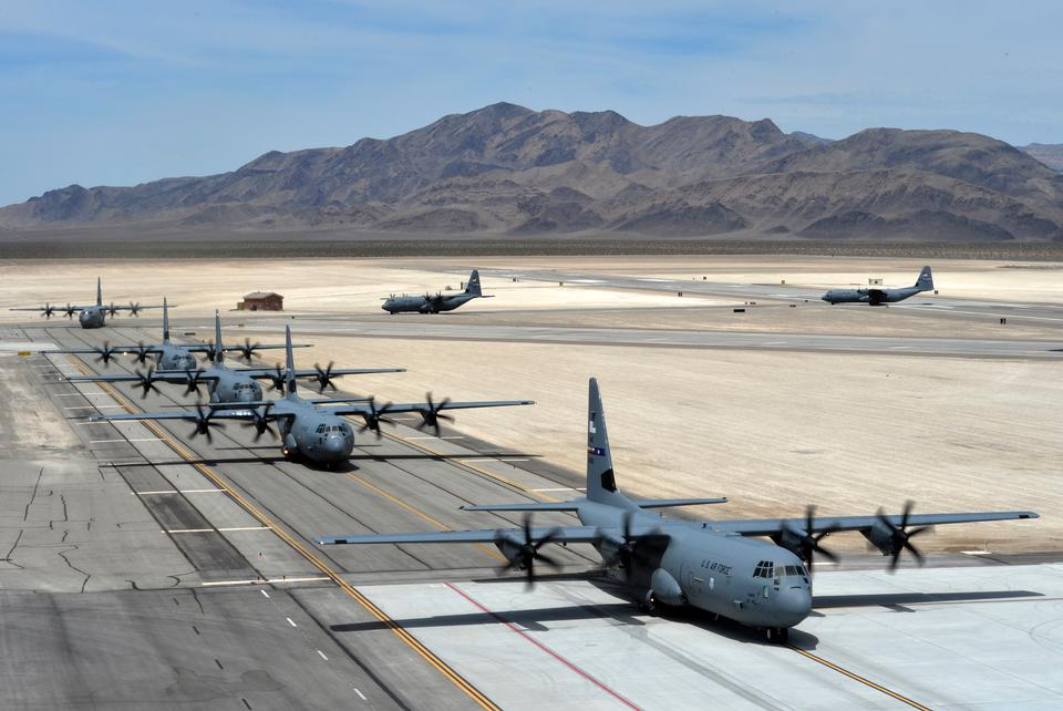 Seven C-130J Super Hercules taxi after landing
