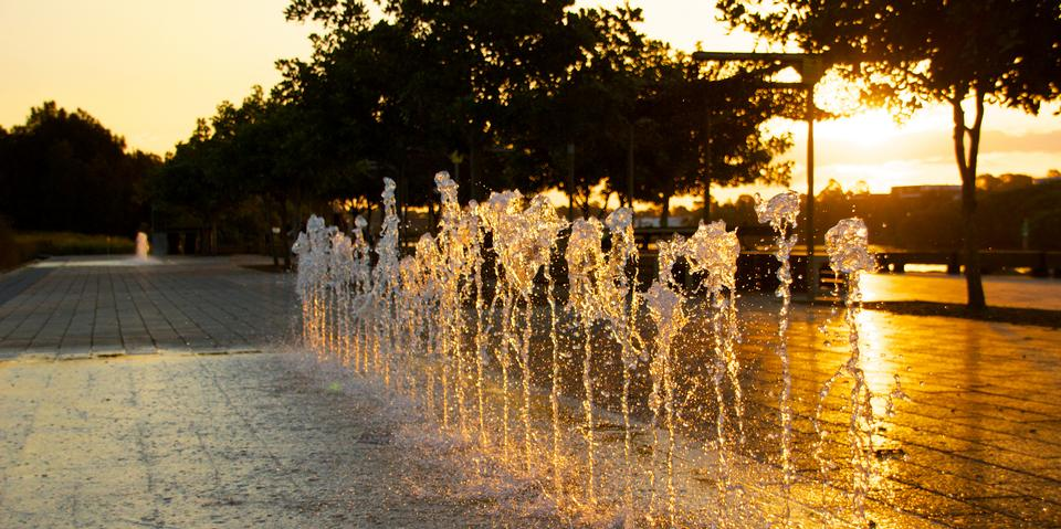 Sunset public park area with fountain