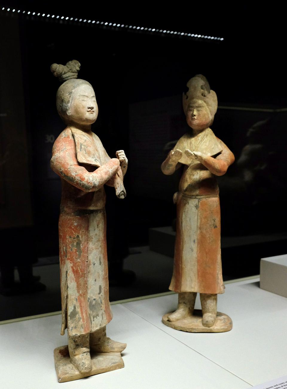 Two female figures in Central Asian dress