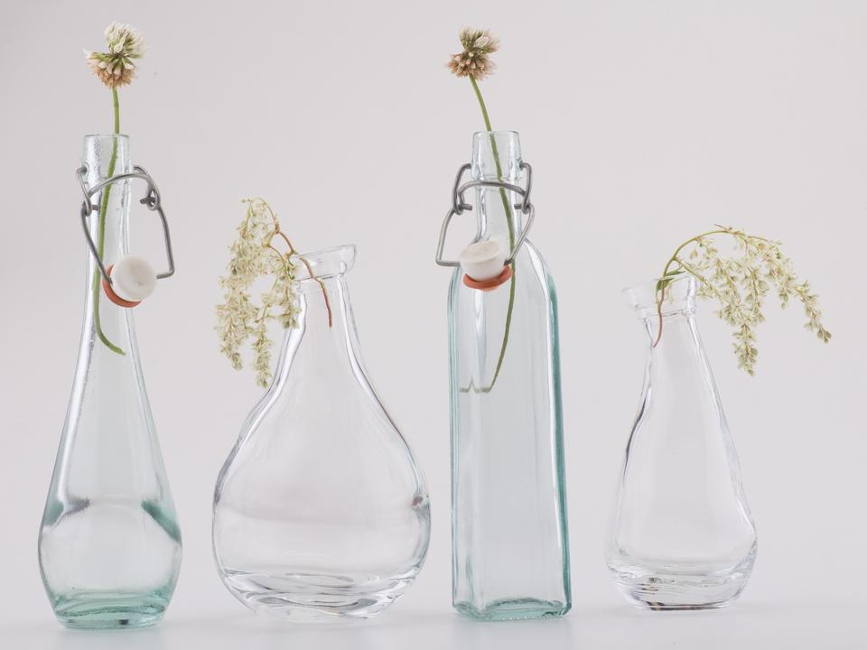 Still life with flowers in glass bottle
