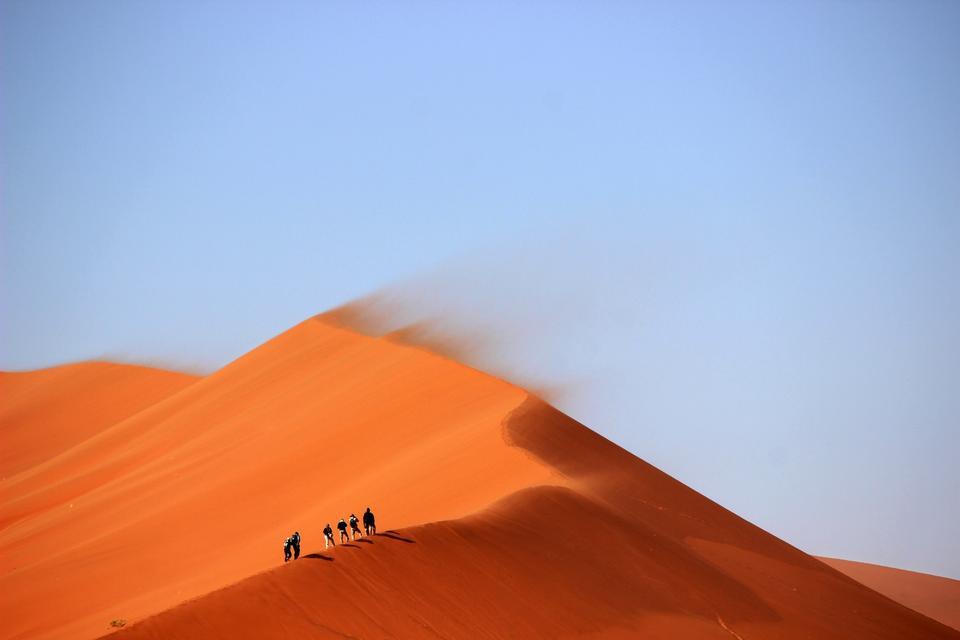 Tourists climb Dune