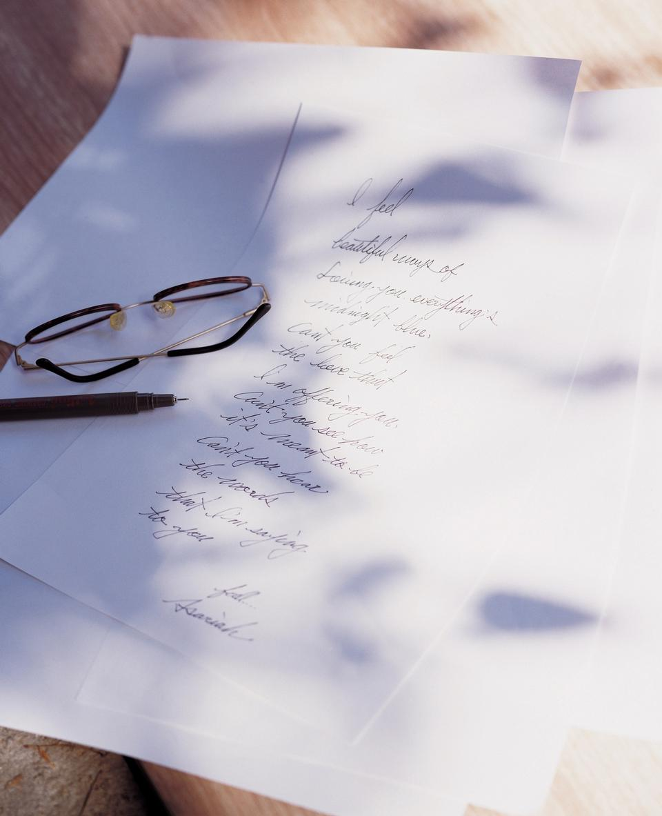notepad with pen, glasses and pencil
