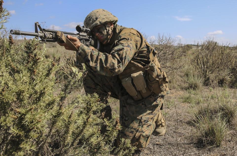 US marine aiming a gun