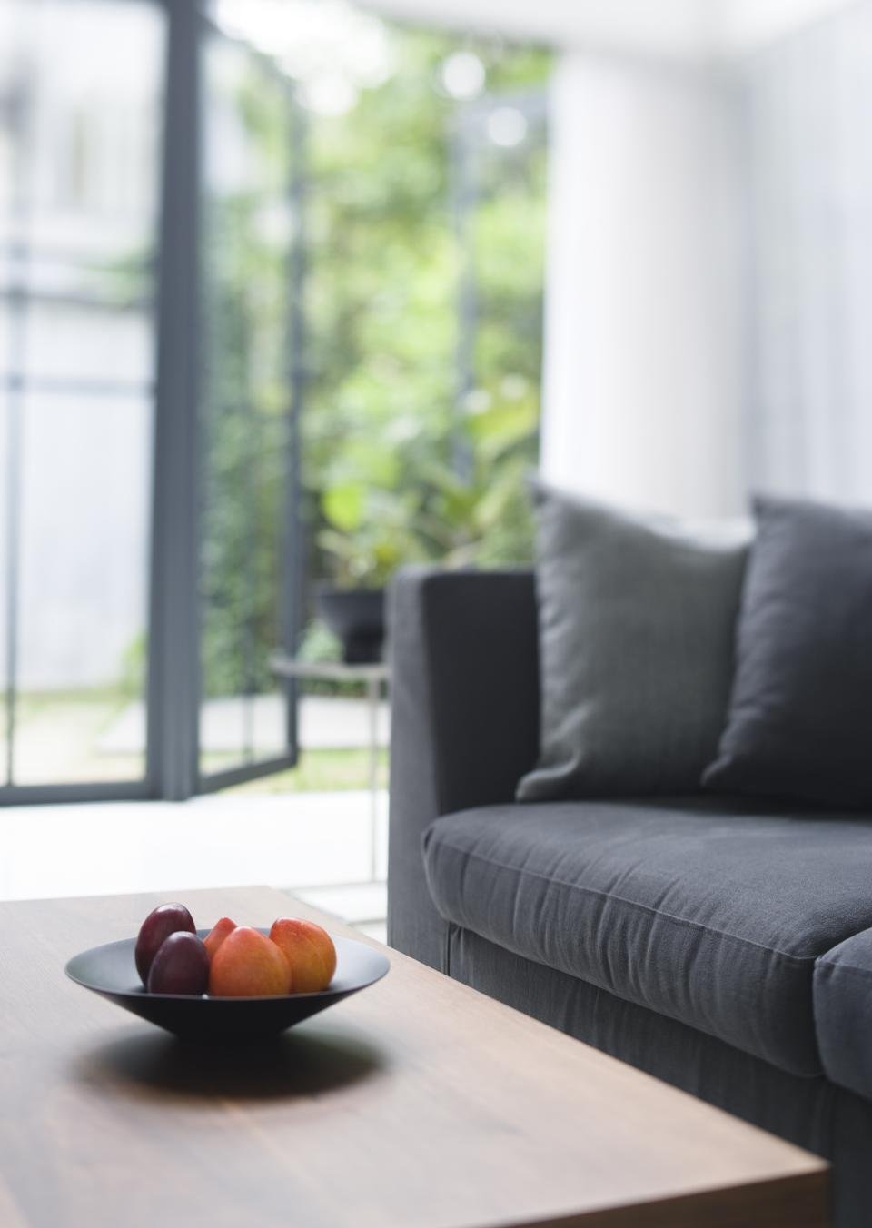 Fresh fruits on table in living room,close up