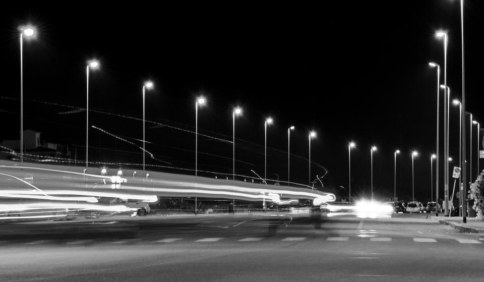 Night time shot of speeding traffic a misty night