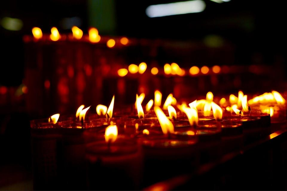 Group of burning candles on black background