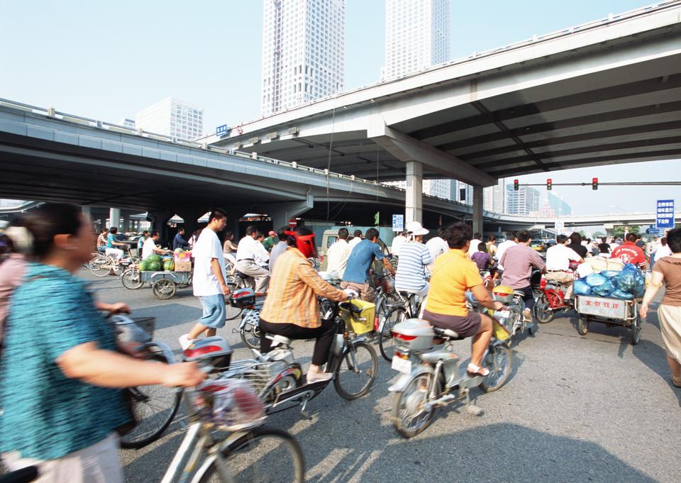 People ride their bicycles on the streets of Beijing, China