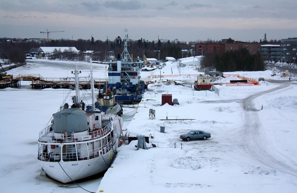 Cargo ships covered in snow