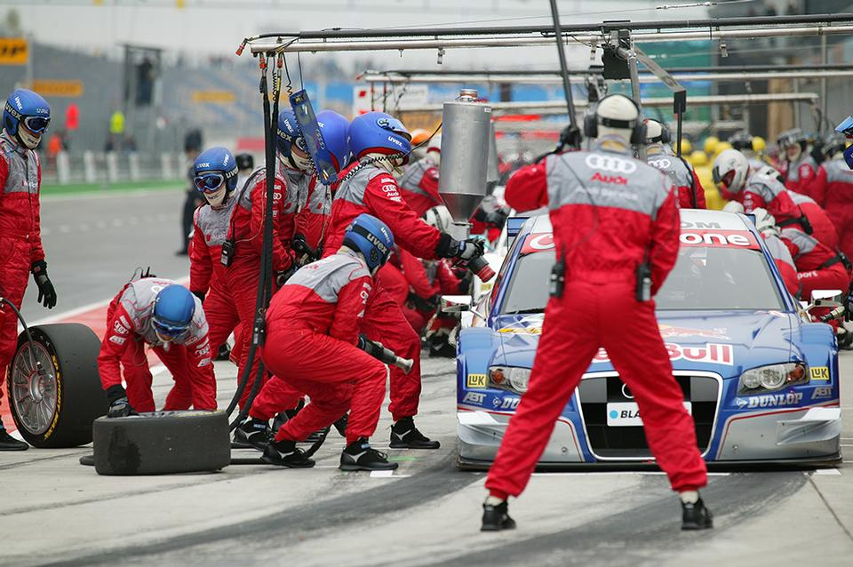 Professional racing team at work during a pitstop of a race car