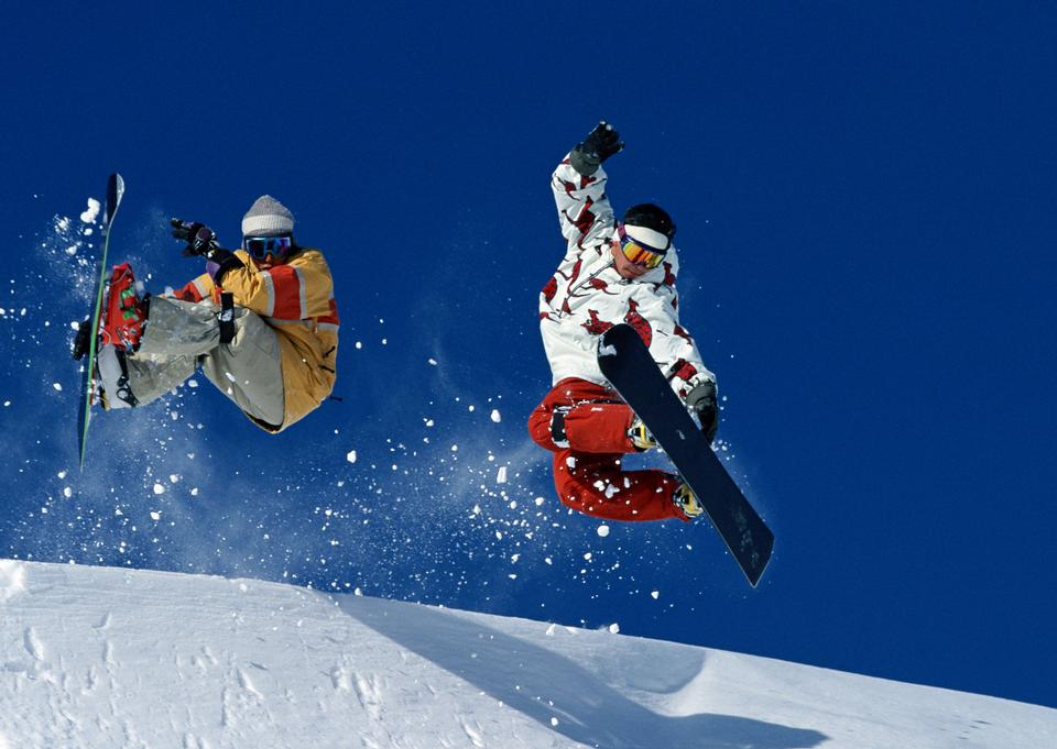 Young snowboarder in deep powder