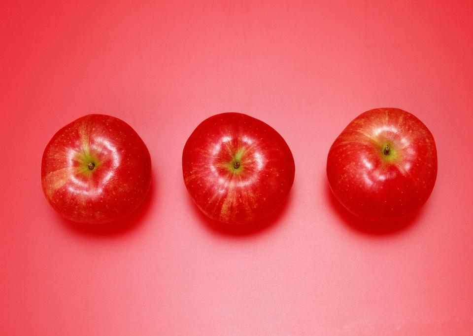 red apples over red background
