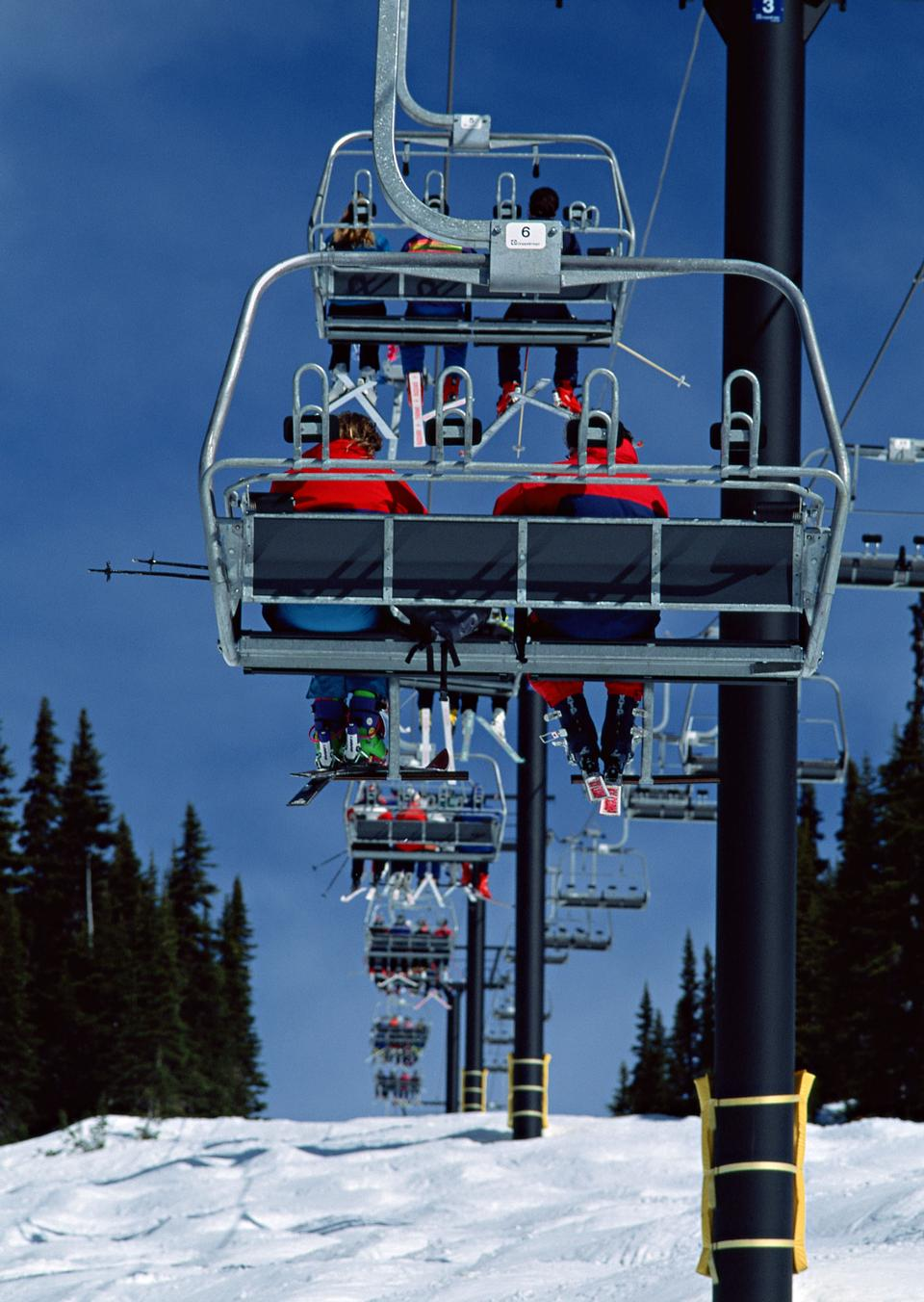 Skiers and snowboarders on a ski lift