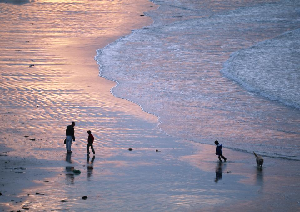 Family Walking Beach Sunset