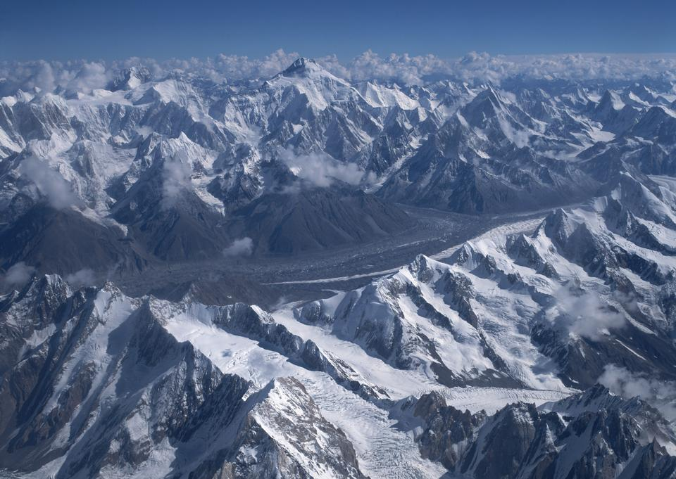 Severe mountains peaks covered by snow