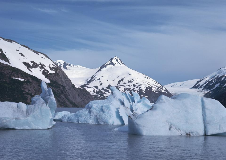 iceberg reflecting in the cool glacial water