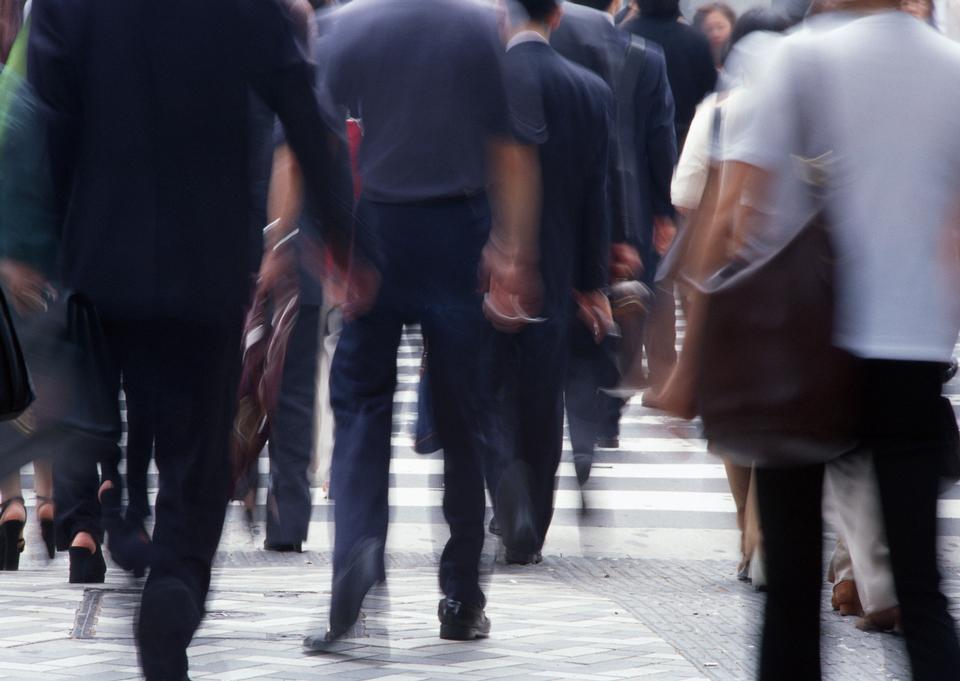 Unidentified businessmen crossing the street
