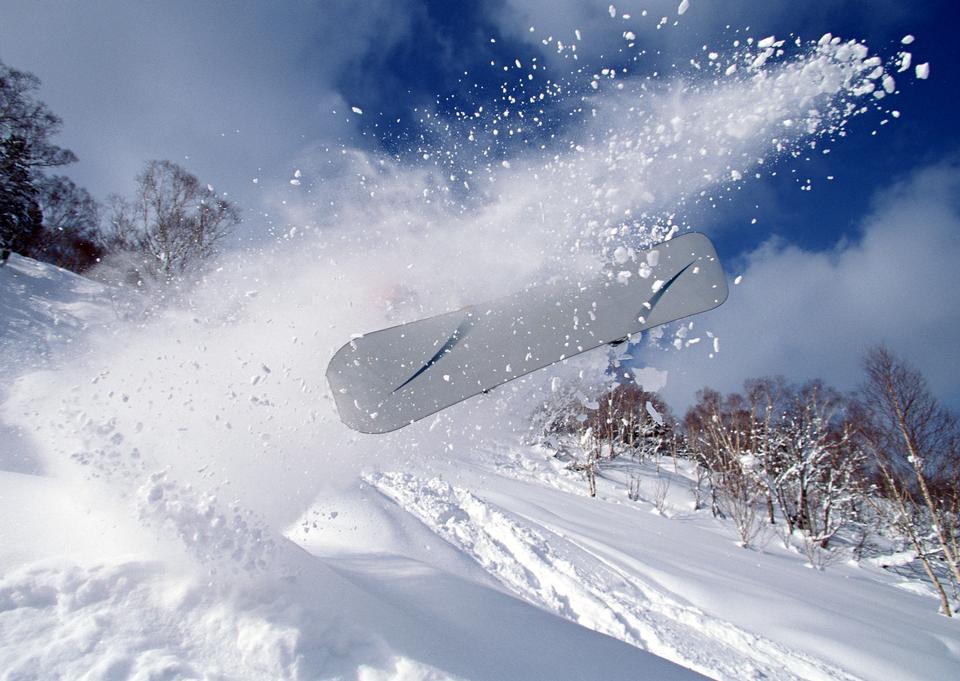 skier in deep powder on a steep slope