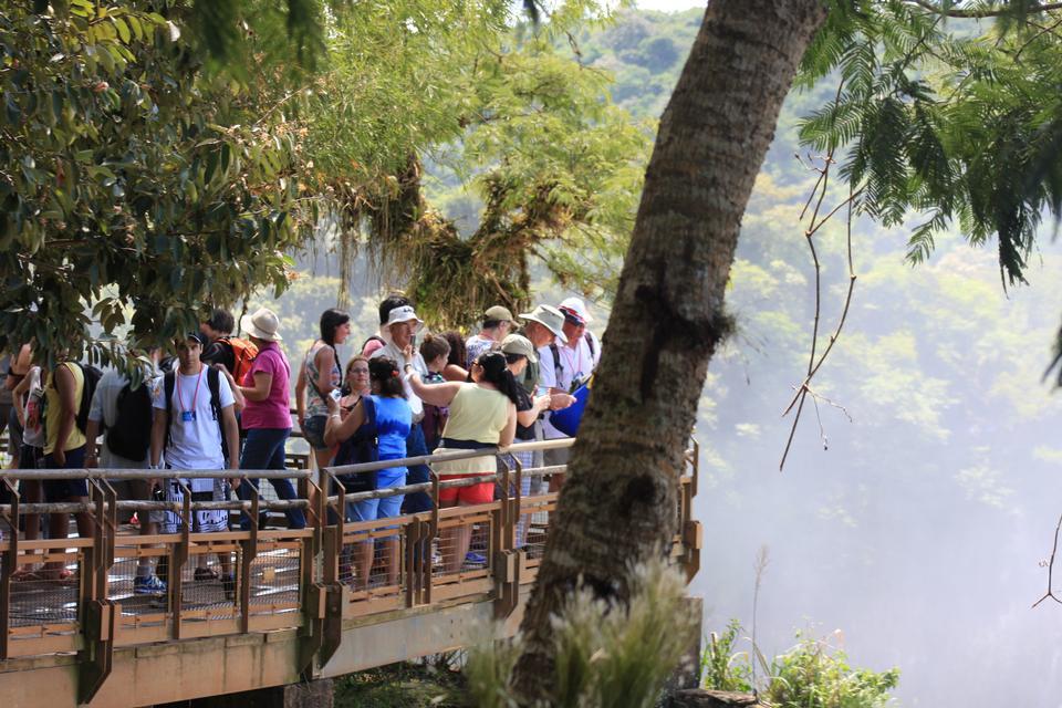 Tourists admire Iguacu falls
