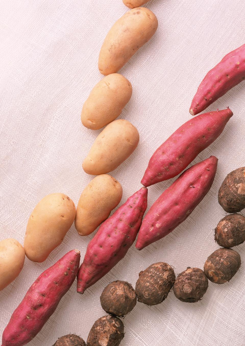 A variety of raw potatoes sweet potato and taro.
