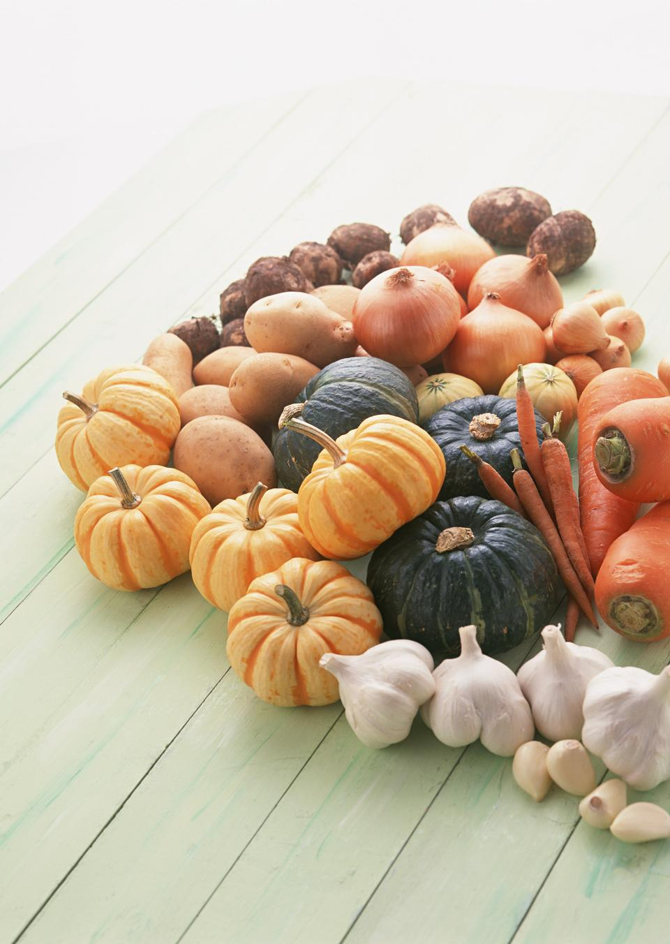Top view of squash and pumpkins on wooden floor