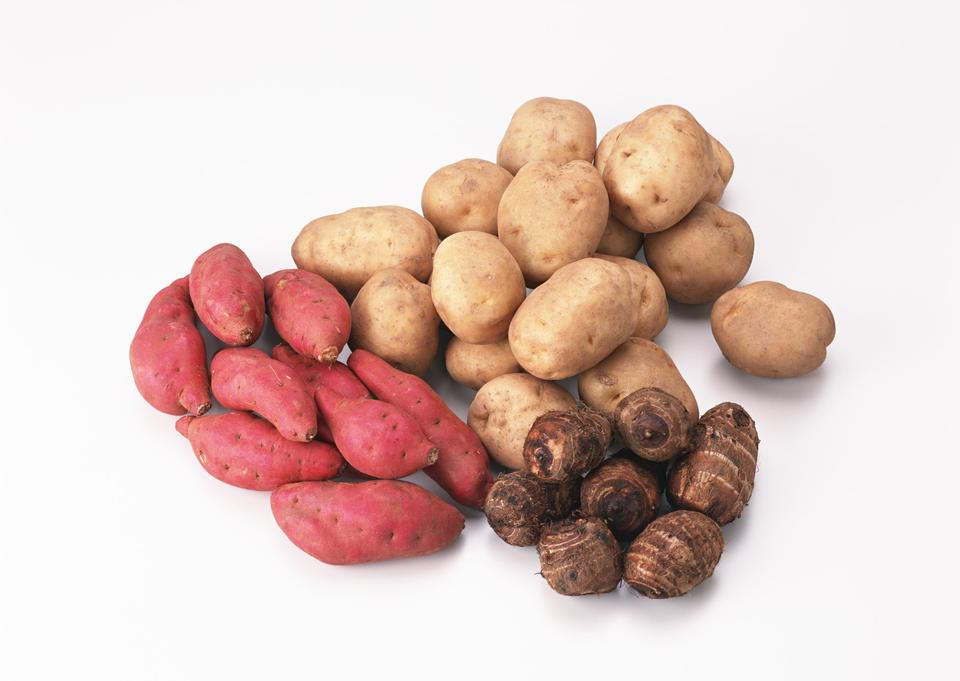 Lots of potatoes,taro, and red and golden sweet potatoes